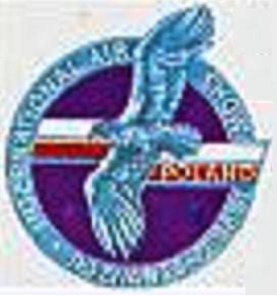 Odznaka, a jednocześnie logo Air Show 91. Na wieńcu napis - International Air Show. Poznań 23-25.08.91.